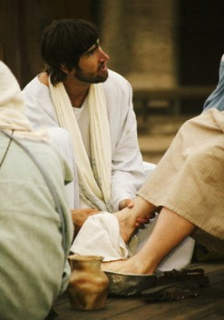 A Person Depicting Jesus Washing Feet